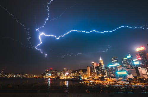 Photo of City Buildings Under Lightning Strike