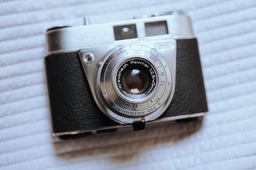 Retro photo camera with lens on fabric