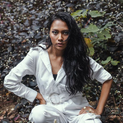 Photo of Woman Wearing White Jumpsuit