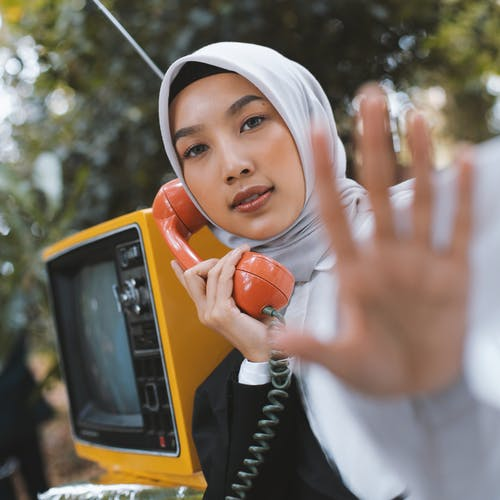 Selective Photo Of Woman Holding Telephone