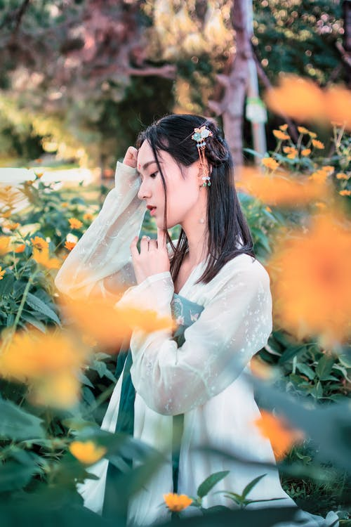 Photo Of Woman Standing Near Plants