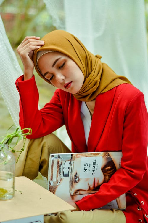 Woman Wearing Brown Hijab Holding Magazine
