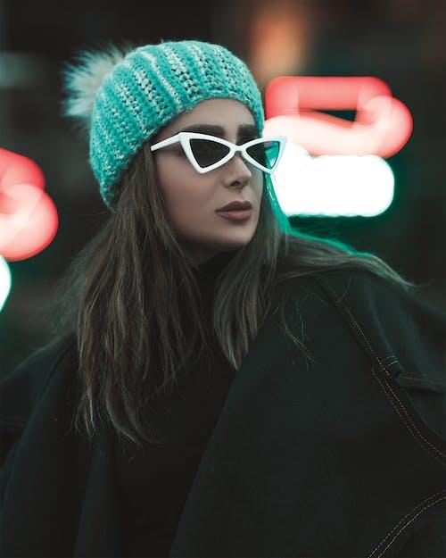 Woman in White Sunglasses