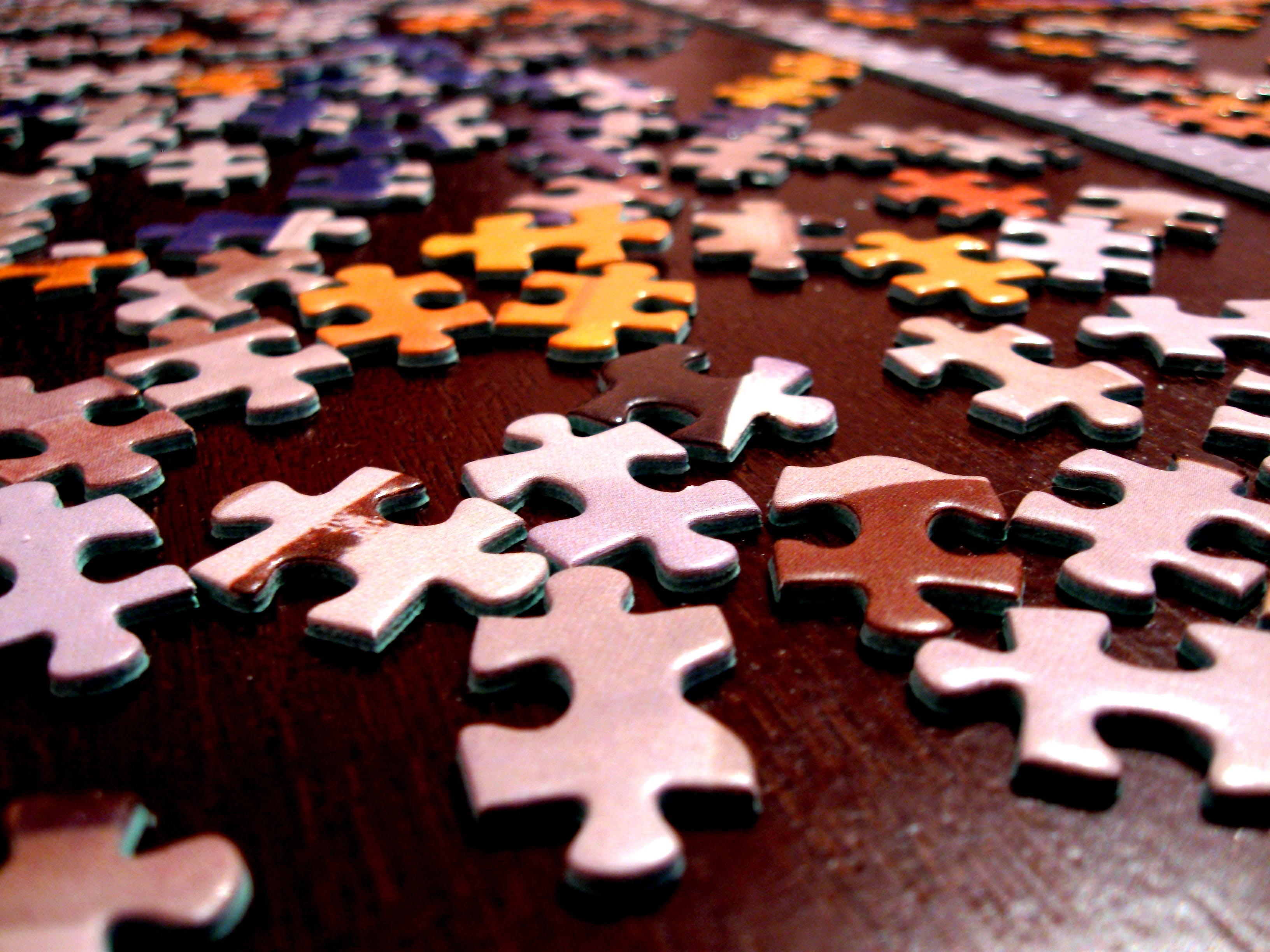 Selective Focus Photography of Assorted-color Puzzle Pieces