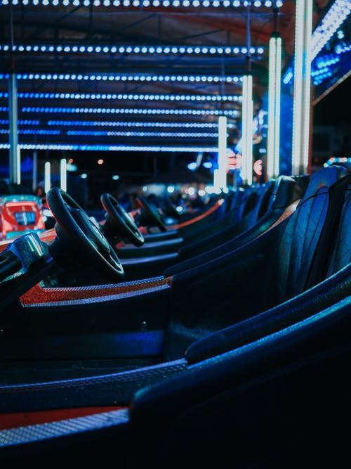 Close-up Photo of Bumper Cars Parked in the track of an amusement park