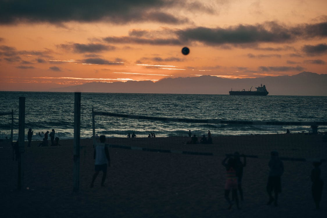 People Playing Volleyball during Golden Hour