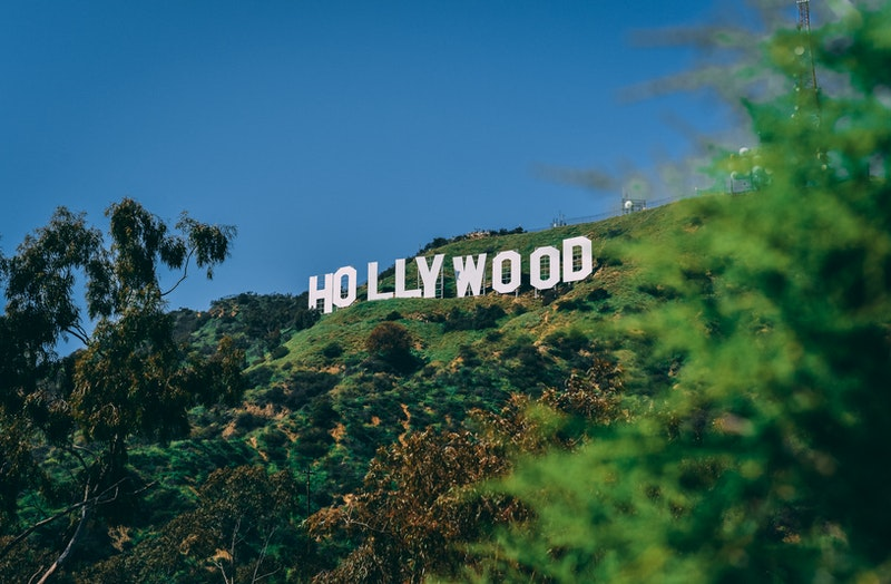 Stand under Hollywood sign