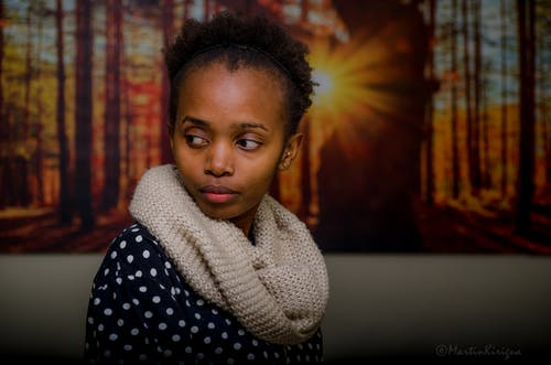 Free stock photo of african american girl, artwork on the wall, background with art