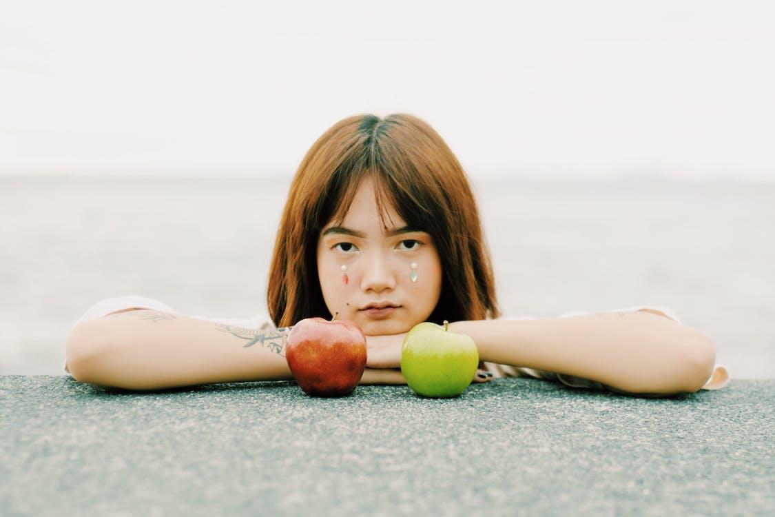 Photo Of Woman Near Apples