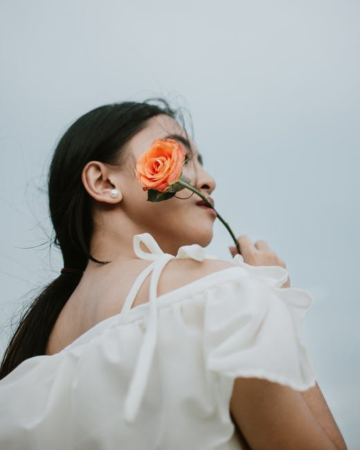 Photo of woman holding a flower