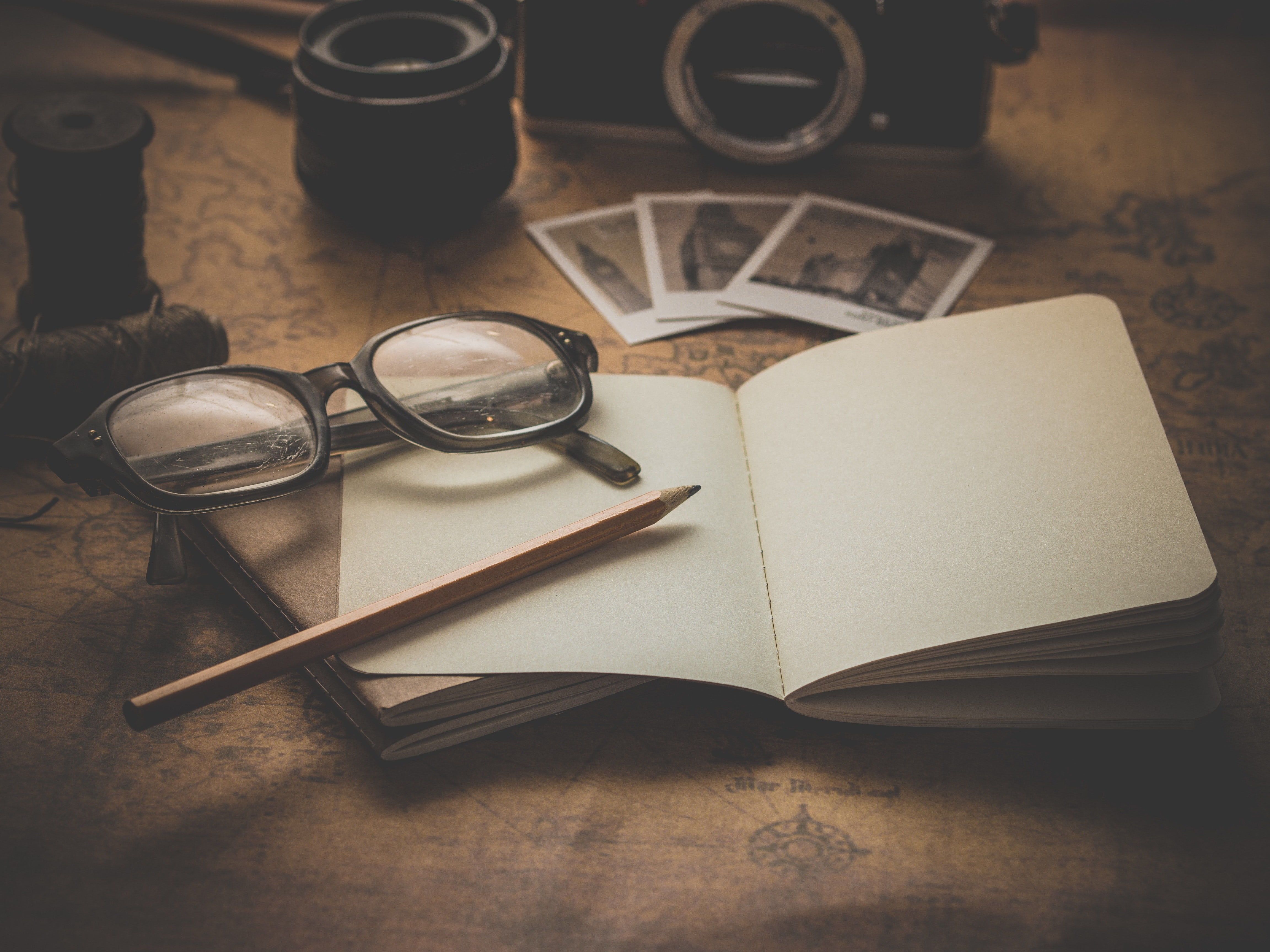eyeglasses and pencil on book free stock photo