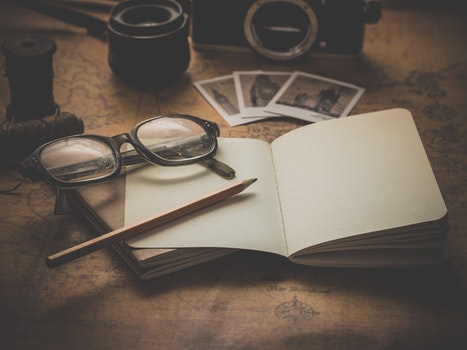 Free stock photo of vacation, camera, desk, notebook