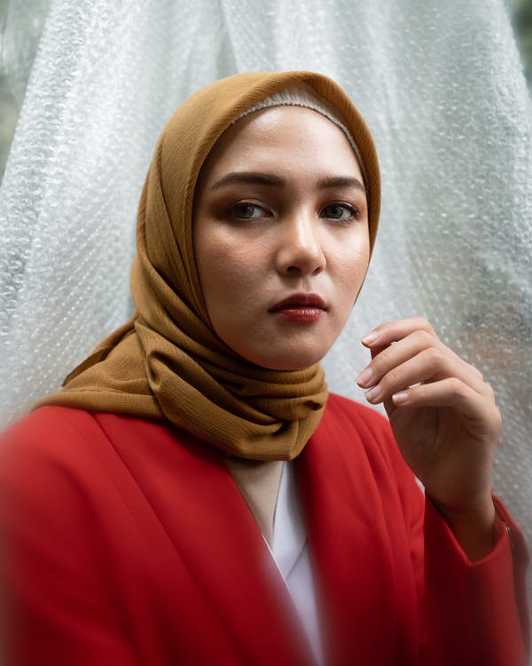 Woman in Red Blazer With Brown Hijab