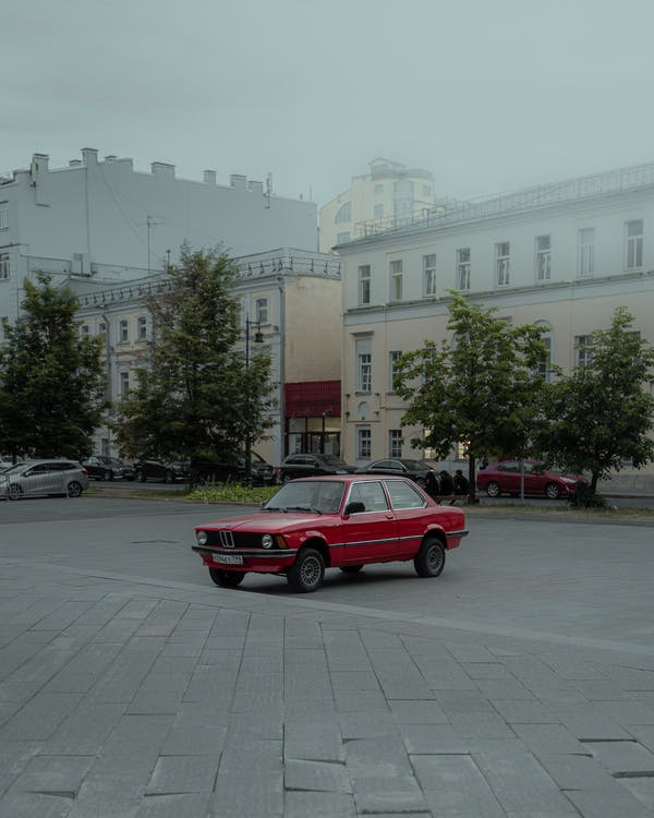 Red Sedan Parked