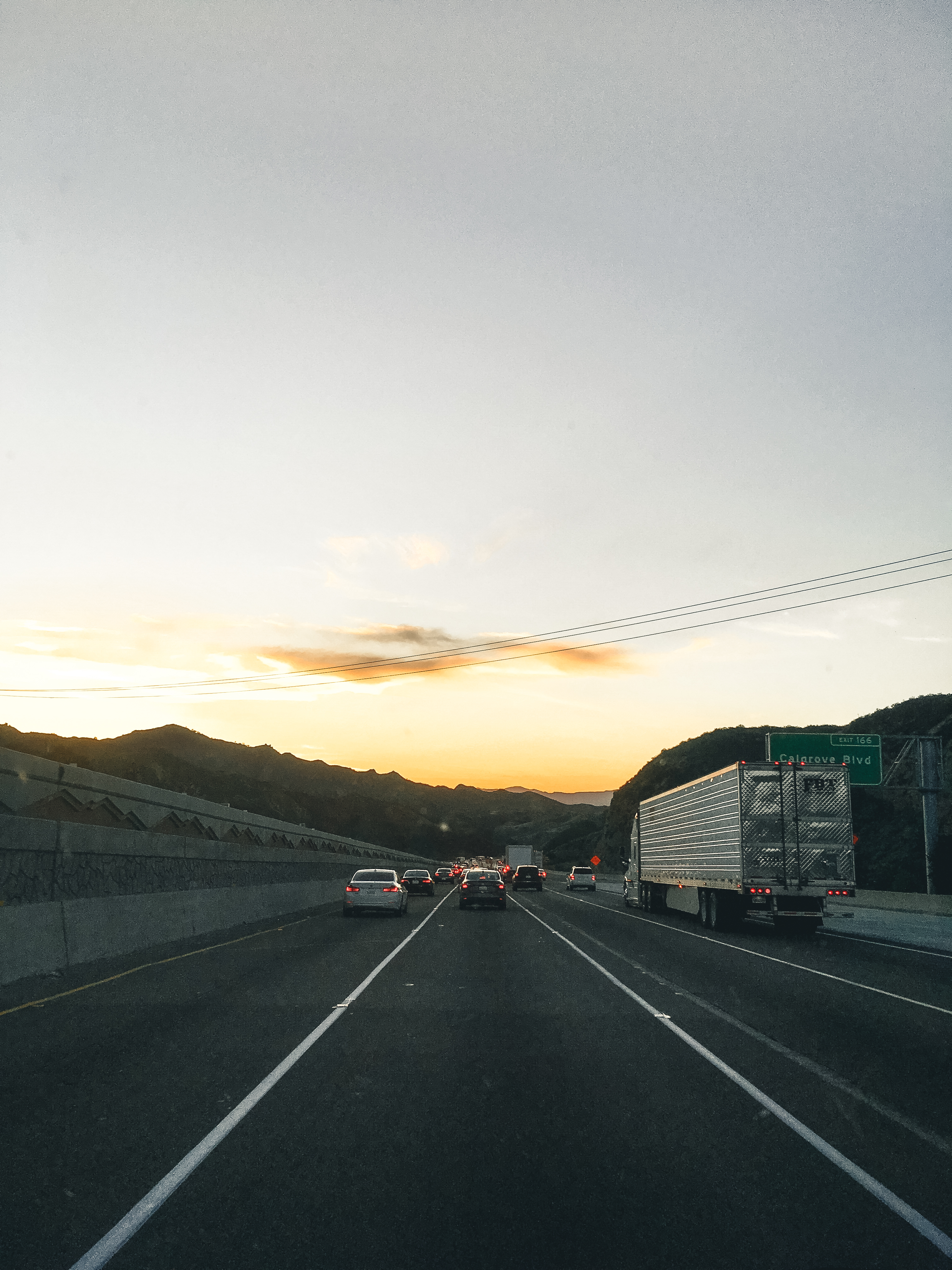 Vehicles on Road During Golden Hour