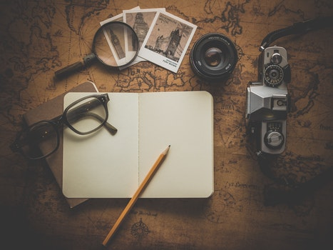 Free stock photo of camera, desk, notebook, pencil