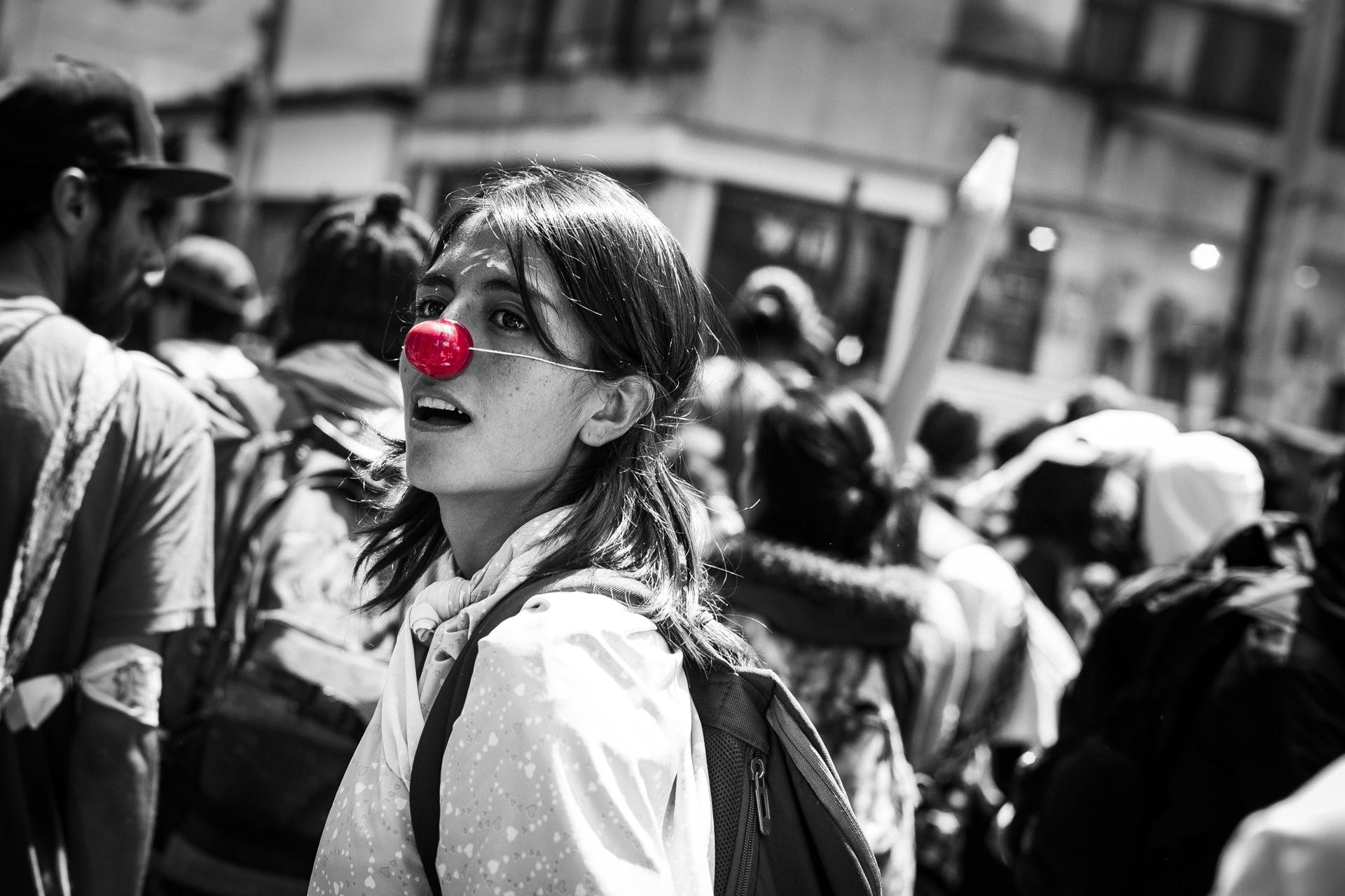 Selective Color Photography of Man With Clown Nose