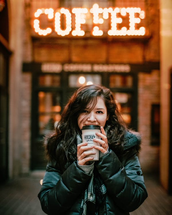 Photo of Woman Wearing Black Leather Jacket Holding A Tumbler