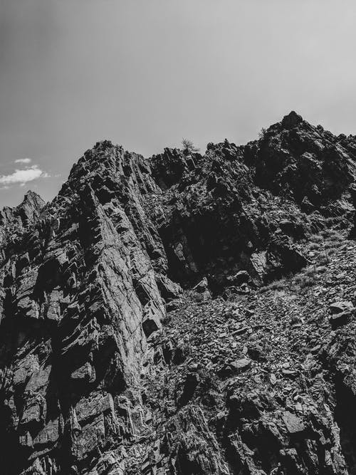 Free stock photo of black and white, cliff, mountain, sky