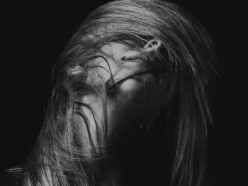 Grayscale Photography of Woman Flipping Her Hair