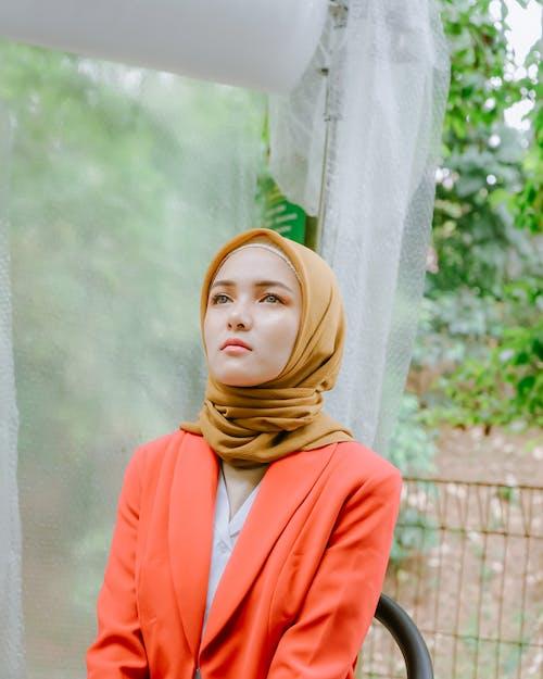Woman in Orange Blazer