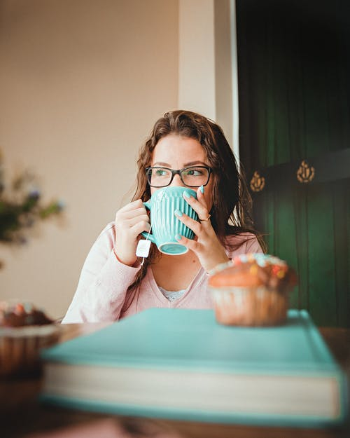 Woman Drinking On A Green Ceramic Mug