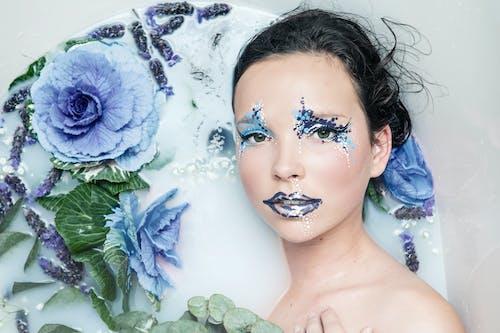 Women Near a Blue Flower Close-up Photography