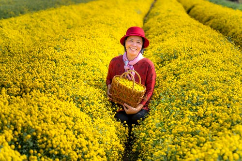 Photo Of Woman Standing On A Flower Field