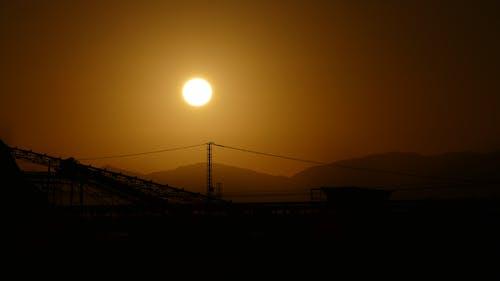 Foto profissional grátis de industrial, pôr do sol, sol