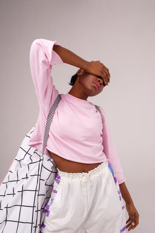 Woman Wearing Pink Long-sleeved Shirt Ad White Drawstring Bottoms
