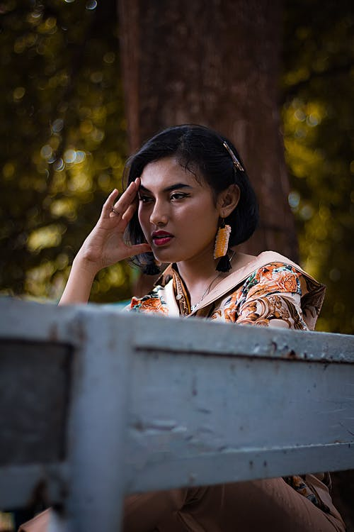 Photo Of Woman Sitting On A Bench