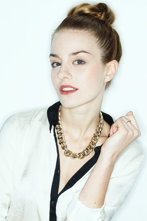 Photo of Woman With Gold Necklace