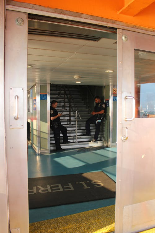 Free stock photo of cell phone, cops, ferry, men