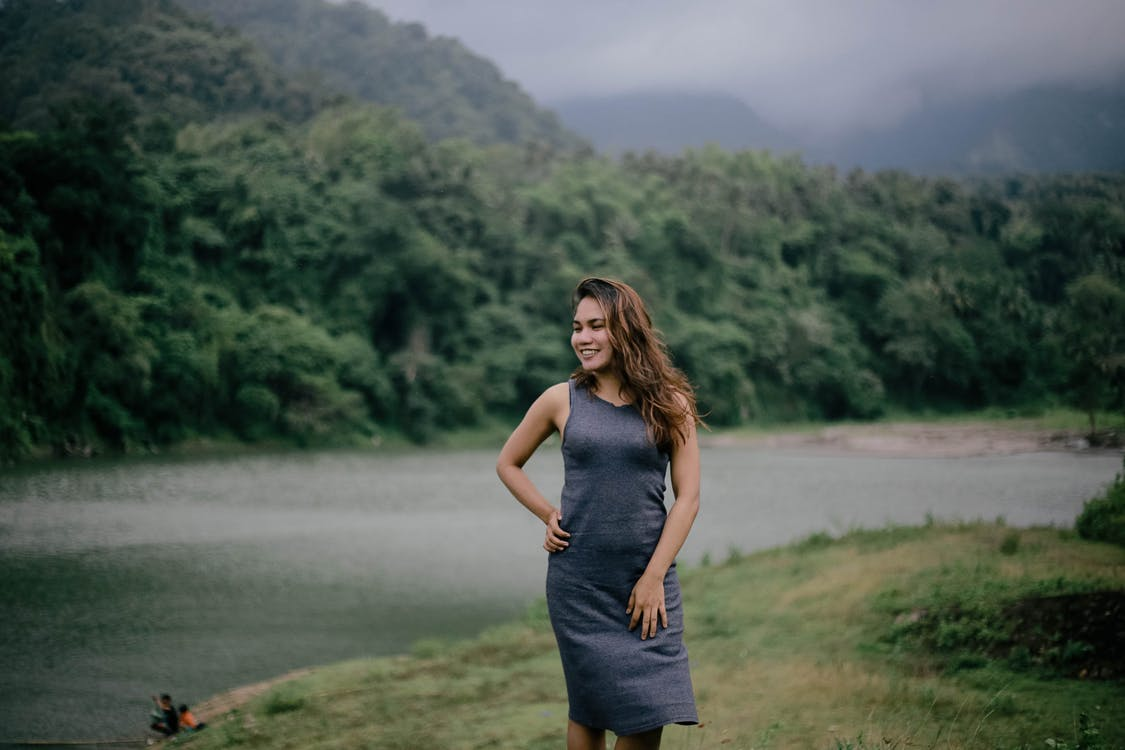 Photo of Woman Wearing Grey Dress