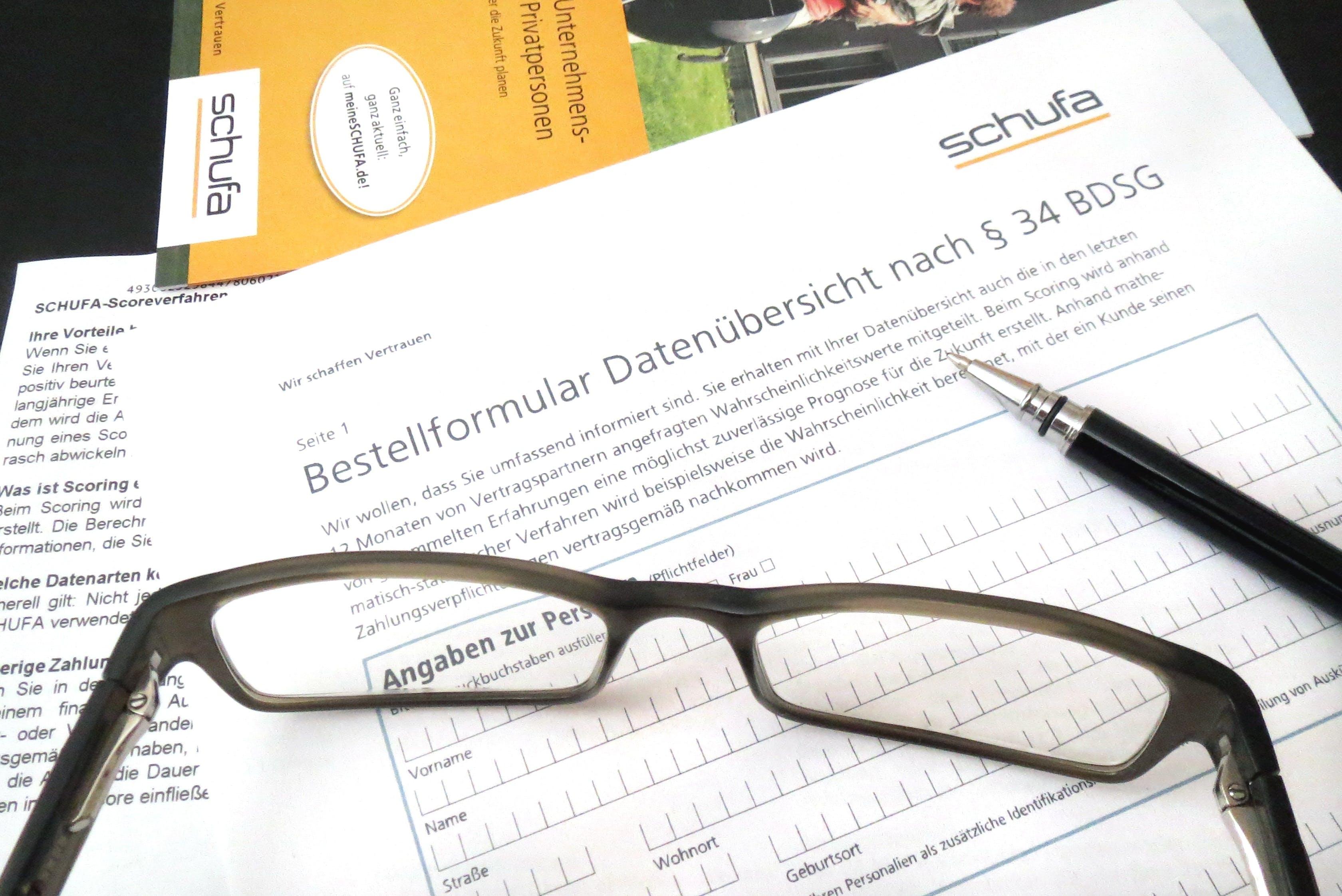 Eyeglasses Beside Black Ballpen