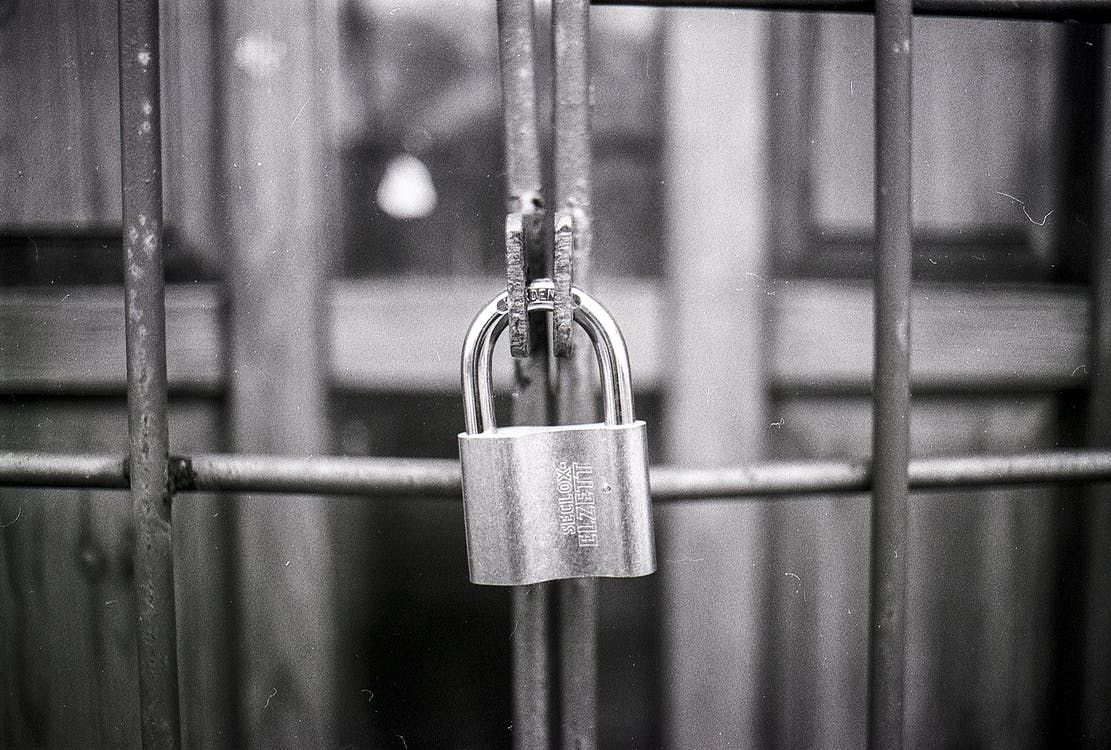 Grayscale Photo of Padlock