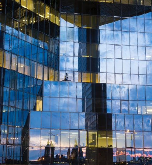 Free stock photo of building, clouds, glass, glass building