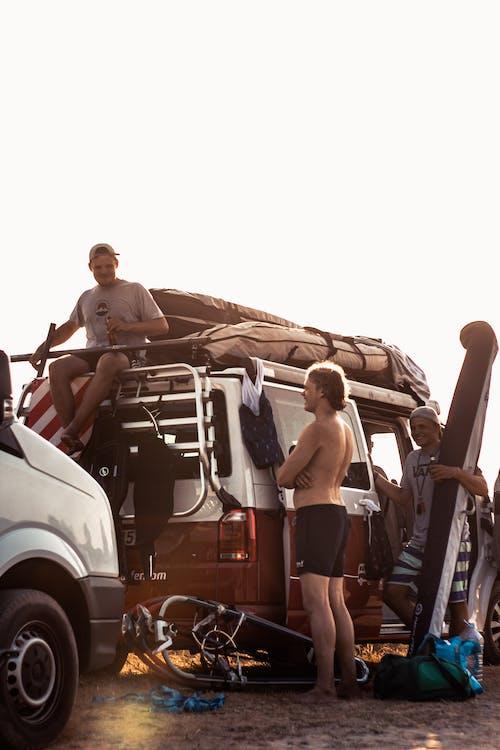 Male friends around camping truck