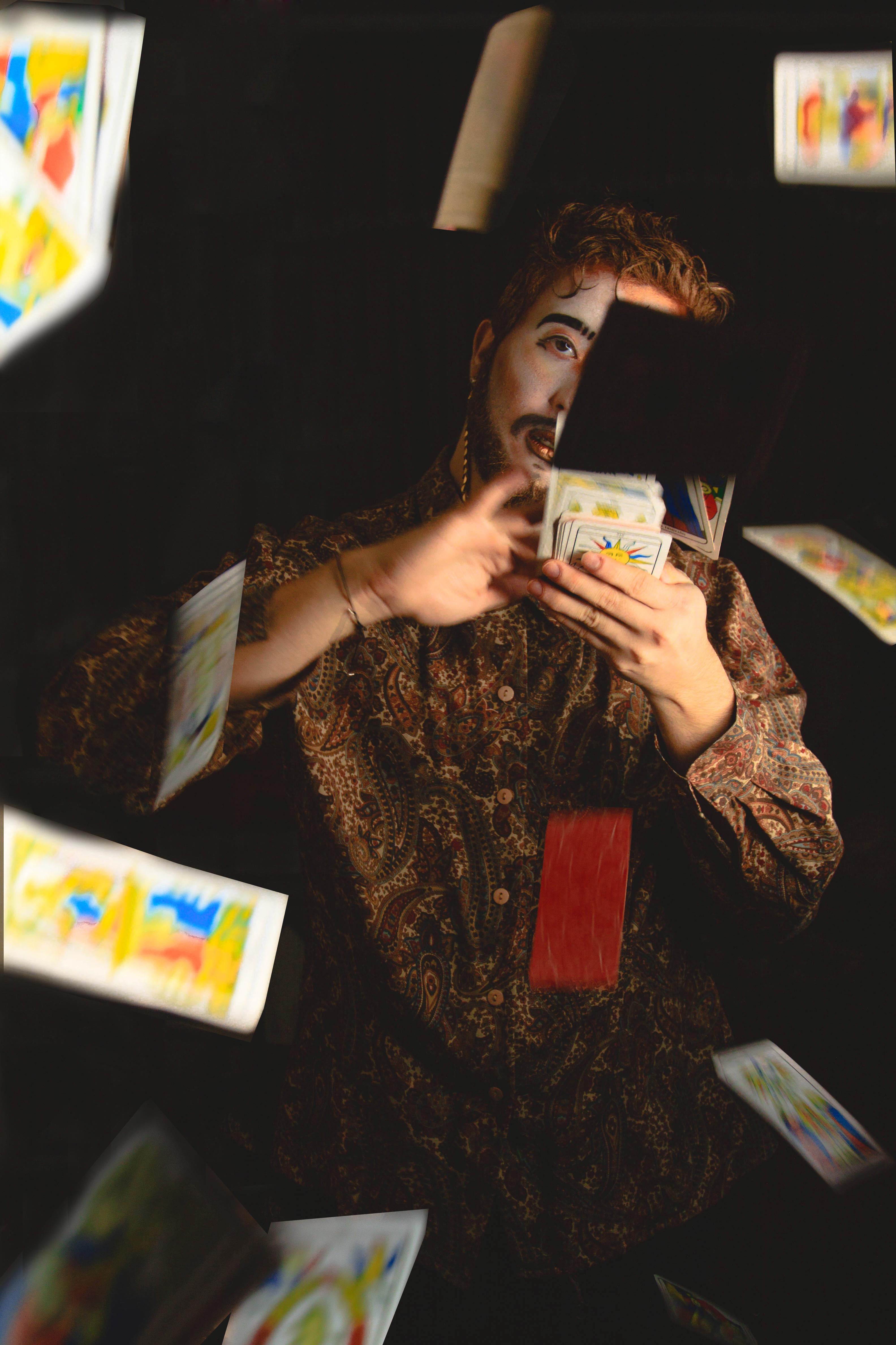Sitting Man Throwing Cards