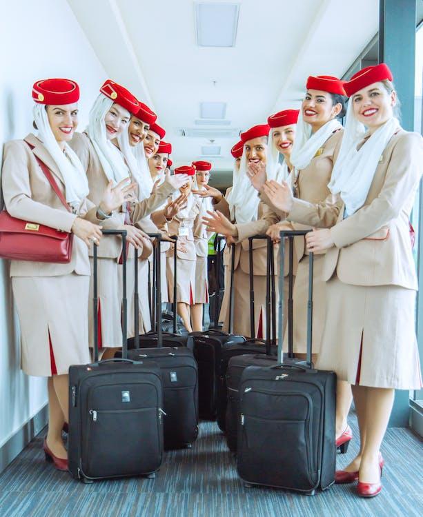 Women In Brown Blazer and Brown Skirt Set