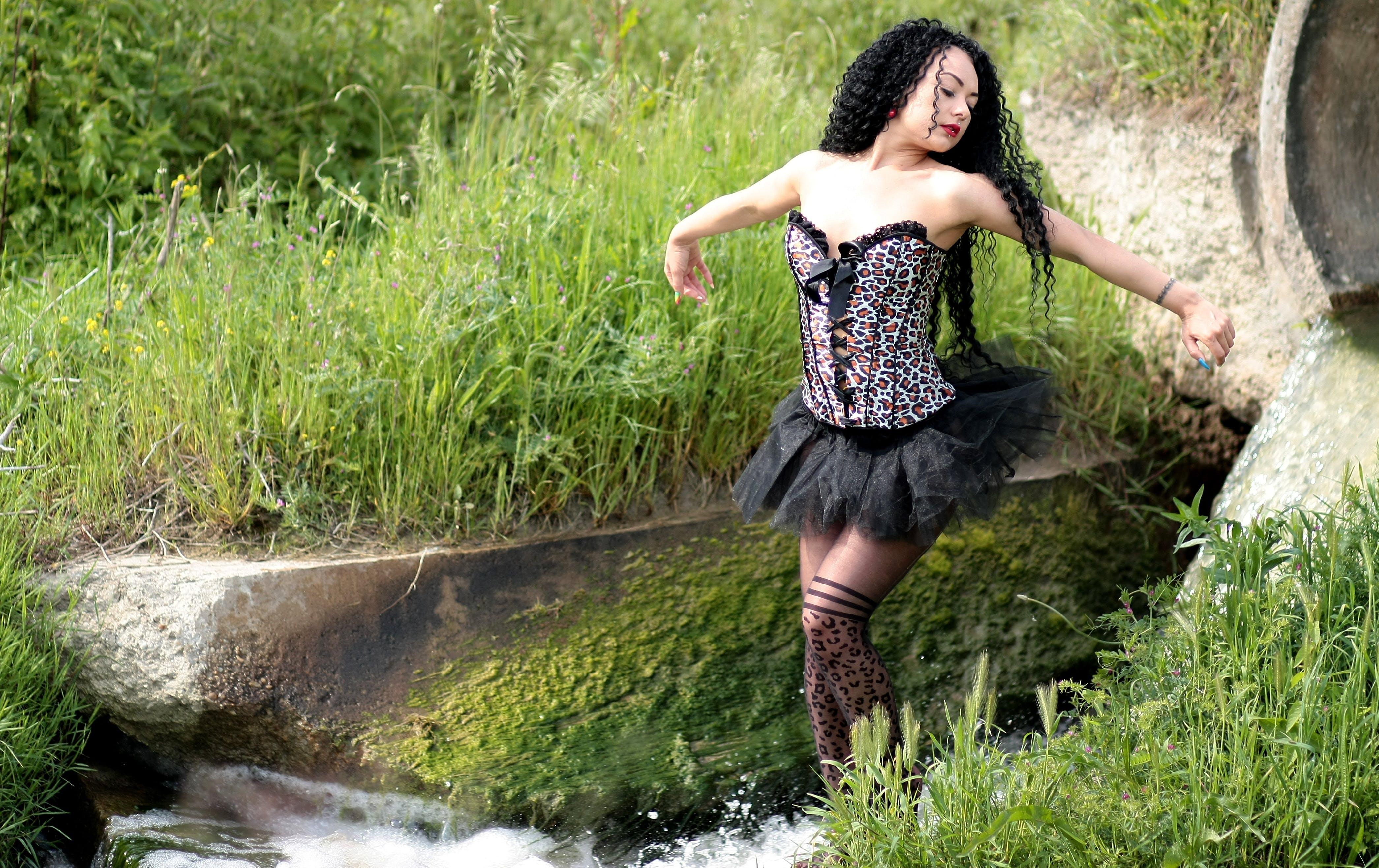 Woman Wearing Black Strapless Dres