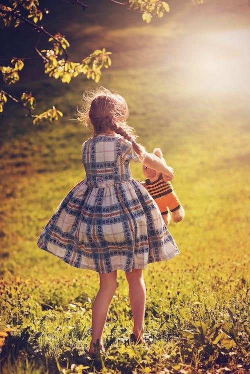 Girl Holding Bear Plush Toy