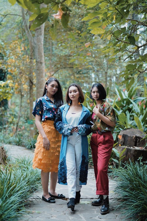 Three Ladies In Different Style Of Clothes