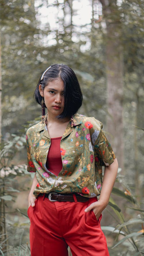 Lady Wearing Red and Green Floral Top And Red Pants