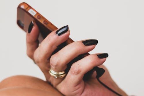 Free stock photo of black nails, fingernails, listening, music