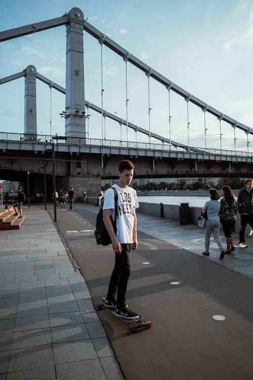 Man Standing on Skateboard