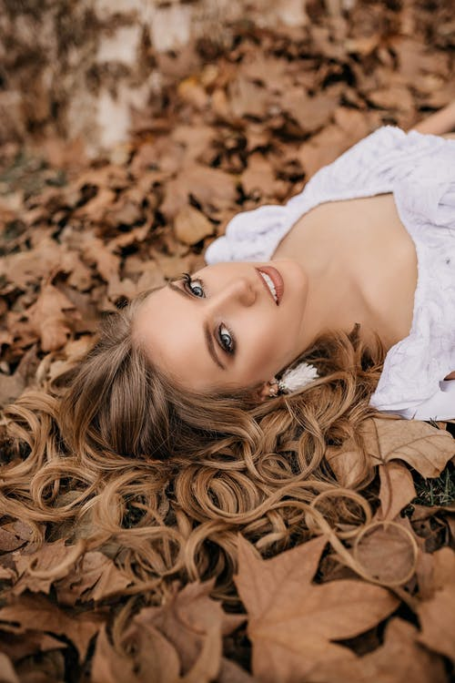 Photo of Woman Lying on Ground