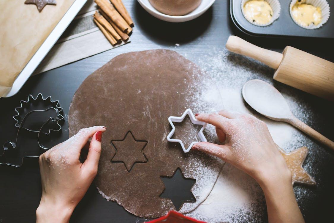 Person Holding White Hexagonal Baking Mold