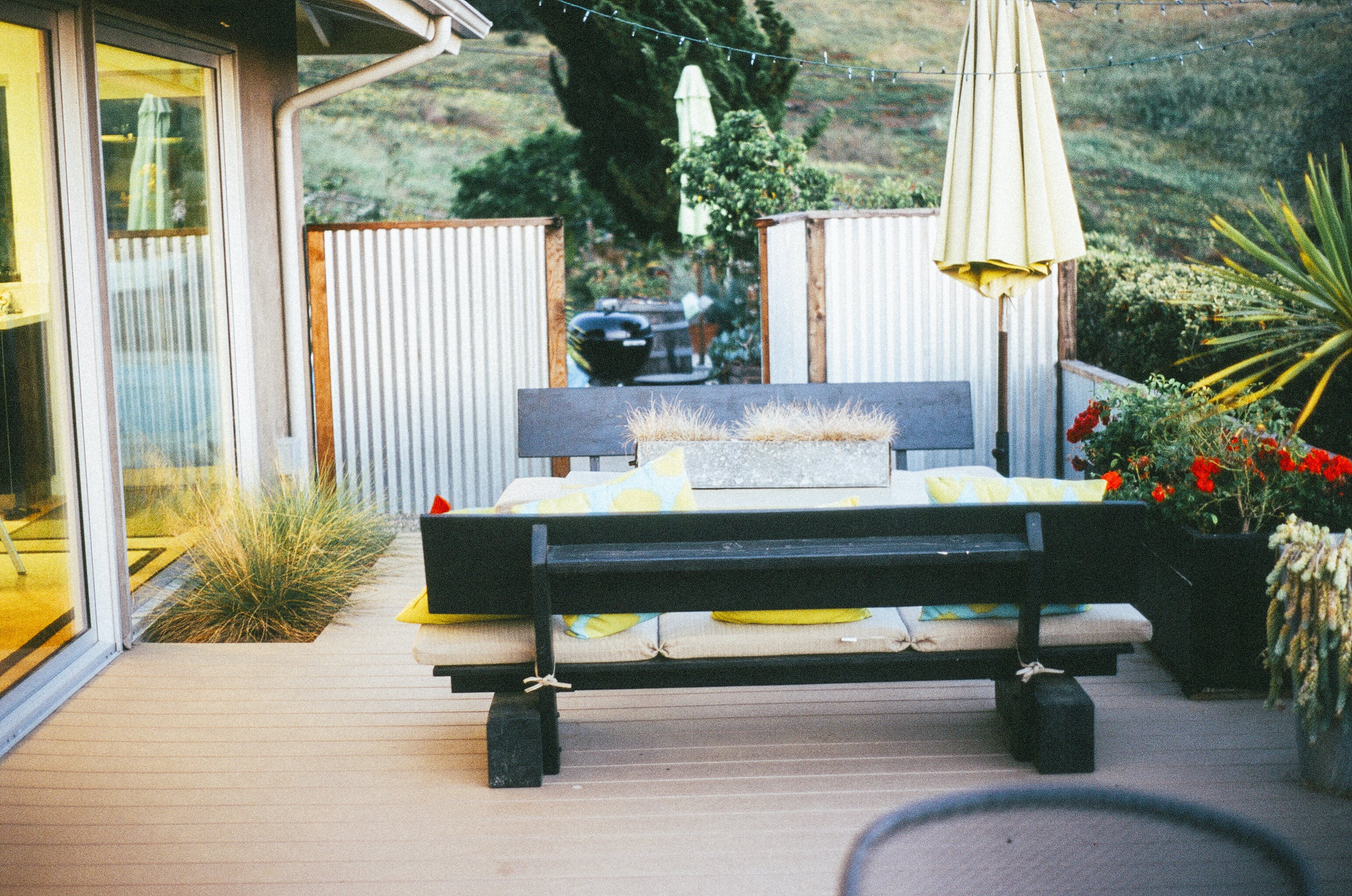 Black-and-beige Wooden 3-piece Patio Set Outside Near House