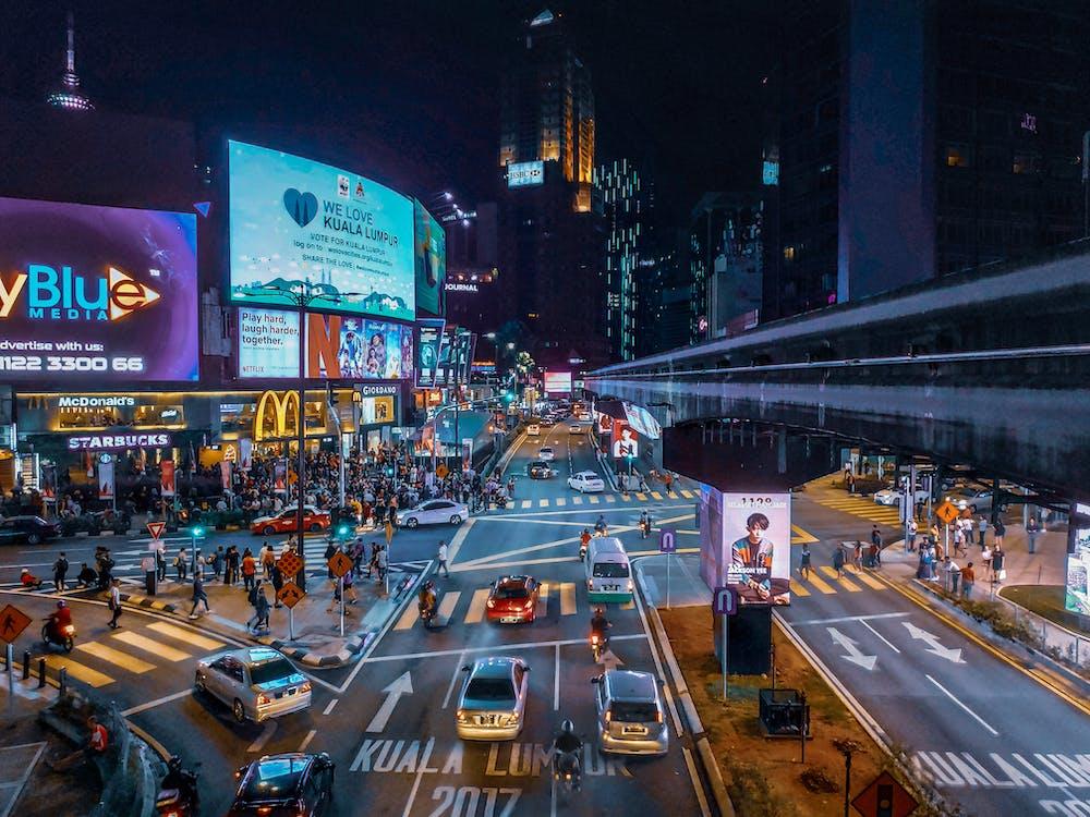 Aerial View of People Walking on Street During Nighttime